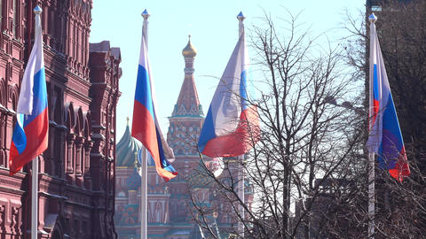 Russian flags against St. Basil's cathedral on Red square in Moscow Footage