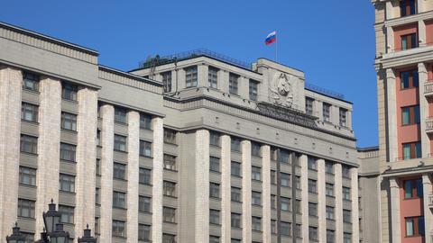 Russian flag above Russian legislative body State Duma. Moscow. 4K video Footage