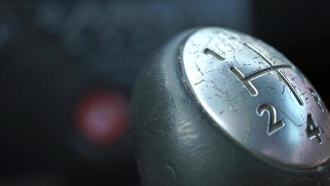 Old scratched gear knob shallow focus close up shot. Shifting the first gear Live Action