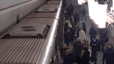 Train arrives and departs from Moscow metro station Kurskaya, zoomed. 16-02-2016 Footage