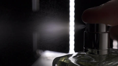 Macro slow motion video of sprayed fragrance Live Action