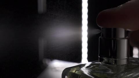 Macro slow motion video of sprayed fragrance Footage
