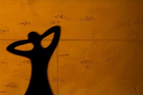 Shadow on the orange wall Foto
