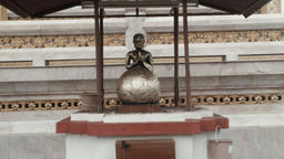 Buddha and Gold Leaf Coated Stone Ball in a Temple Footage