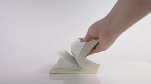 Slow motion of hand flicking the pages of a book Live Action