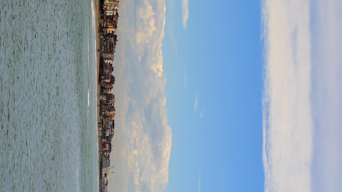 Vertical video. Clouds over the coast. Ostia, Rome, Italy. Time Lapse Footage
