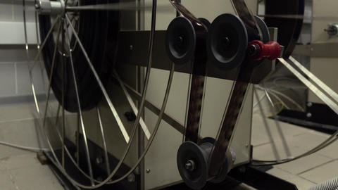 Dolly shot of moving parts in pro cinema projector, 4K video, part of set Footage