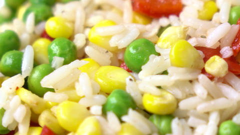Mix of rice, corn, peas and red sweet pepper, 4K macro dolly shot Footage