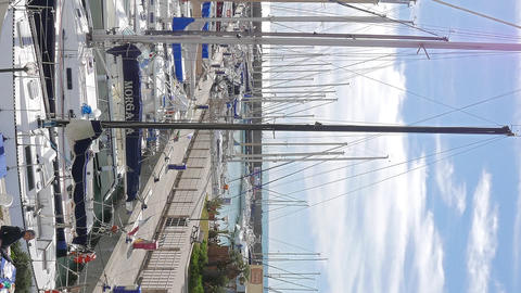 Vertical video. Yachts in the port of Ostia, Italy Footage