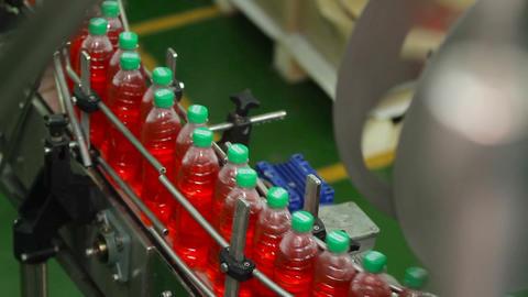 Bottling of juice in plastic bottles Footage
