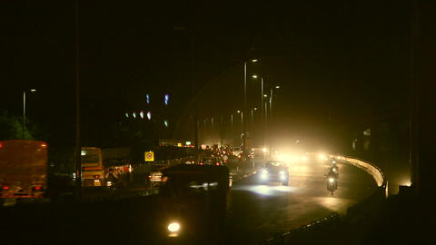 Chennai city at night busy time. Traffic on road in a city at night, Chennai Live Action