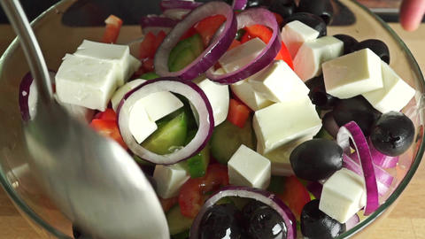 Mixing Greek salad close up video Footage
