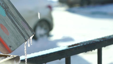 Drip of thawing snow in residential area, 120 fps slow motion video Footage