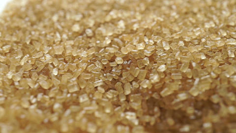 Shallow focus dolly shot of granulated brown sugar Live Action