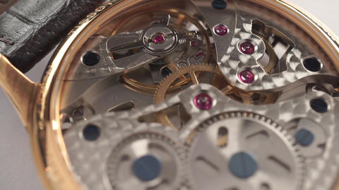 Expensive wrist watch mechanism in action, close up dolly video Footage