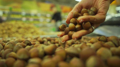 Handful of hazelnuts in a supermarket, slow motion video Footage