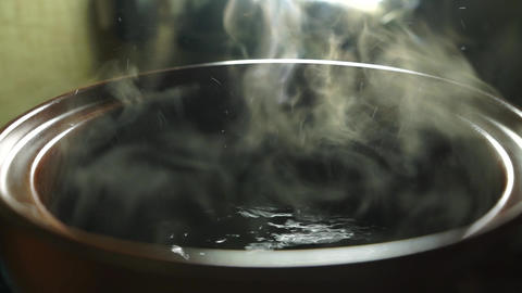 Slow motion video of cooking pasta in boiling water Footage