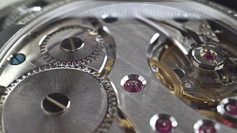 Close up dolly shot of precise watch movement Live Action