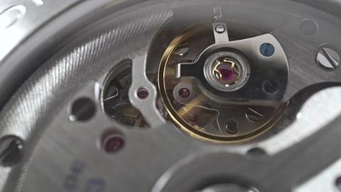 Macro dolly shot of Swiss made wrist watch movement Footage