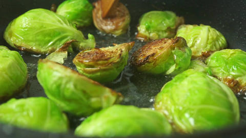 Turning over fried Brussels sprouts close up shot Footage