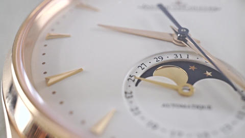 Luxury golden wrist watch with phase of the Moon indicator. Macro dolly shot Footage