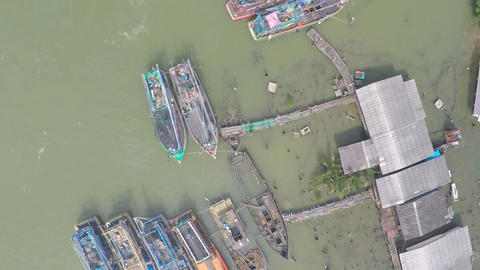Aerial video of Thai fishermen village and old fishing vessels Footage
