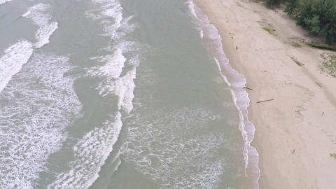 Aerial slow motion video of sea surf and sandy beach Live Action