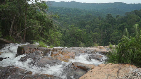 Top of the waterfall and jungle haze, slow motion video Footage
