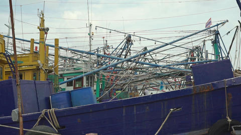 Moored old fishing vessels and Thai flag Footage