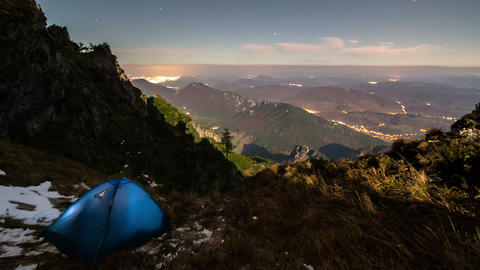 Camping in mountains under night sky with moonlight time lapse 영상물