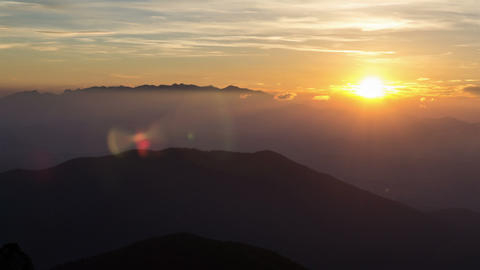 Colorful sunrise over mountain in foggy morning time lapse Footage