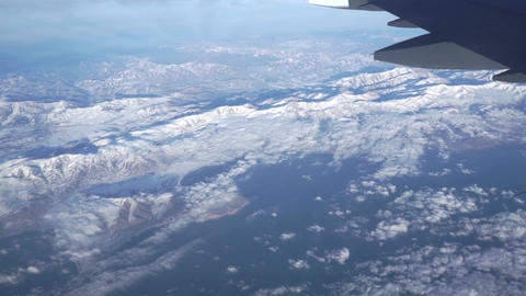 Distant mountains beneath the airliner. Aerial video Footage