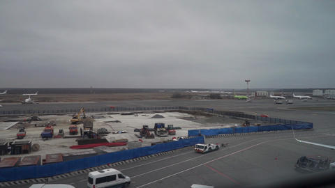 Construction site and taxiing off plane at Moscow Domodedovo airport Footage