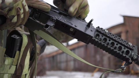 Attaching a magazine to assault rifle. Close up shot of airsoft equipment Live Action