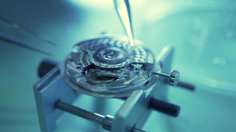 Watch movement being repaired in a repair shop. Macro video Live Action