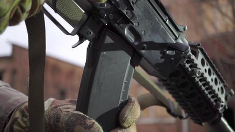 Attaching a magazine to Kalashnikov assault rifle. Close up shot Live Action