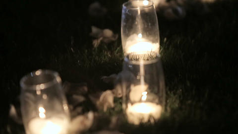 Romantic burning white candles in glass vases standing on... Stock Video Footage