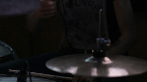 close up, drummer playing on drum set. Concert rock band performing on stage wit Footage