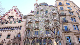 Casa Batllo facade, tilt up and down, few tourists in front of famous building GIF