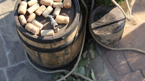 Dated Wine Bottle Corks On A Barrel Of Wine stock footage