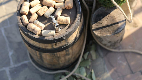 Dated wine bottle corks on a barrel of wine Stock Video Footage