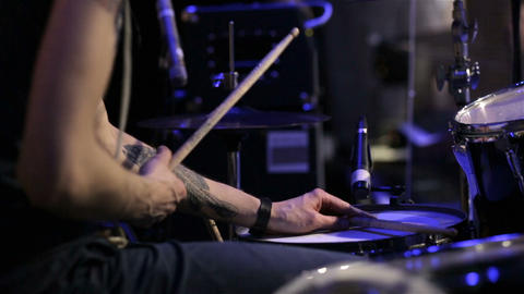 Drummer on stage. close up. Drummer playing on drum set at a rock concert. Contr Footage