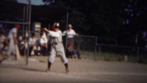 1964: Boy batting little league baseball game takes bad pitches Footage