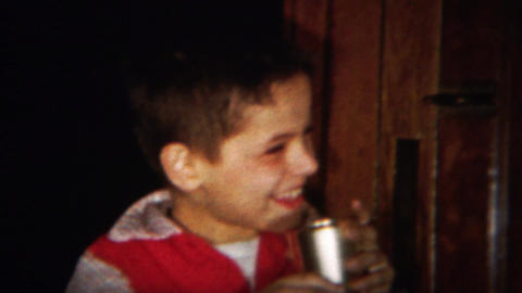 1964: Adorable Happy Young Boy Drinking Silver Cup stock footage