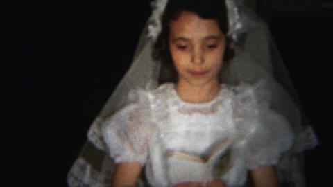 1964: Sweet young humble girl reading bible practicing holy communion Footage