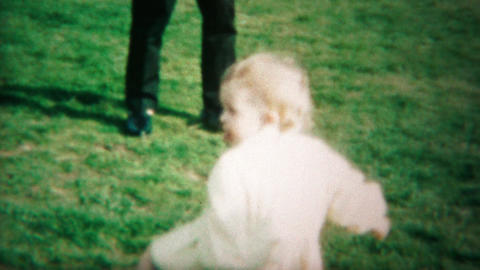 1964: Happy babies wrestling dancing outdoor park lose interest Footage