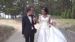 Bride And Groom Walk In The Park Footage