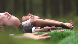 Happy Bride And Groom Lying Down On The Grass stock footage