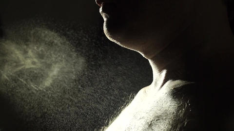 Unrecognizable man sprays his perfume on his chest, slow motion video Footage