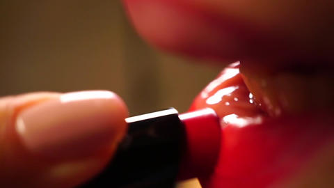 Girl using red lipstick, macro video Live Action